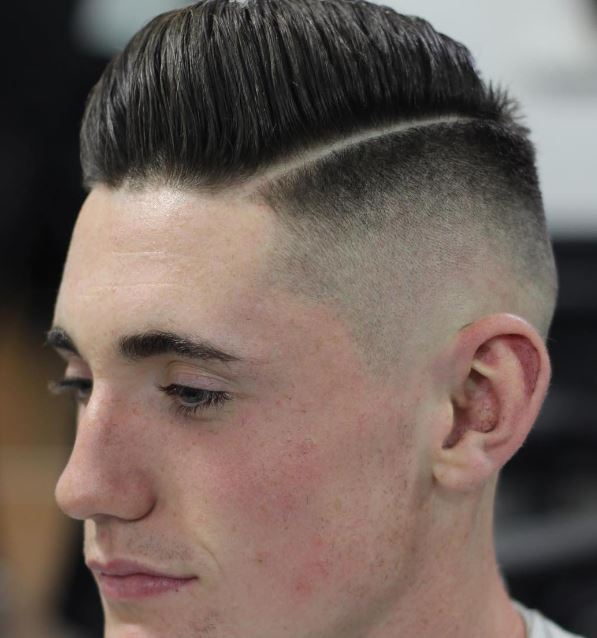 bald fade medium length pompadour